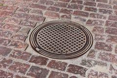 Pavement & hatch sewer manhole Stock Photo