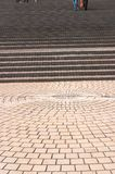 Pavement leading to broad stairways. Pavement leading to or from broad stairways. Patterns Stock Photo