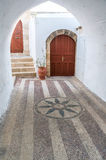 Pavement of Lindos, Rhodos, Greece. Pavement mosaic of Old Town Lindos, Rhodos, Greece royalty free stock images