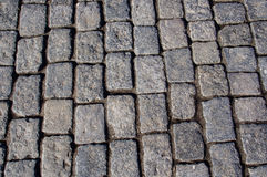 Pavement made of granite. Background Stock Photos