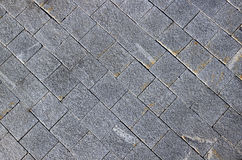 Pavement made of grey granite paving stones Stock Photos