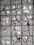 Pavement made from old cracked concrete tiles.  Royalty Free Stock Image