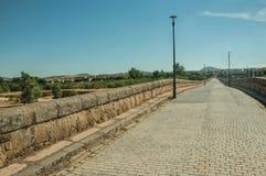Pavement made of setts on top of Roman bridge int Merida royalty free stock image