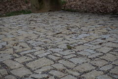 Pavement made of stones, cobbles and gravel Royalty Free Stock Photo