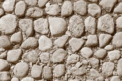 Pavement from a natural stone of sepia color Royalty Free Stock Photo