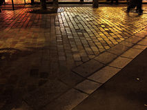 Pavement in paris. Wet pavement in paris street by night stock photos