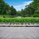 Pavement and park. Pavement view of beautiful park on blue sky Stock Images