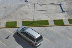 Pavement parking lot construction. View from above. Pavement parking lot construction with car, green grass and street lamp. View from above Stock Image