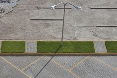 Pavement parking lot construction. View from above. Pavement parking lot construction with green grass and street lamp. View from above Royalty Free Stock Image