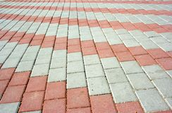 Pavement with pattern. Pavement with a pattern from red and gray rows of concrete blocks Royalty Free Stock Image