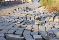 Pavement of paving slabs, requiring repair. Stock Photo