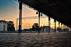 Pavement of paving stones at the railway station, at sunset. Transport infrastructure Stock Photos