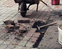 Pavement repair from pavers Stock Photos