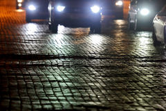 Pavement of the road at night by the light of cars royalty free stock photo