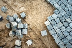 Pavement rocks, stones and cobblestone blocks, construction of path, road or sidewalk Stock Images