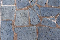 Pavement of stone slabs. gray stone surface interspersed with volcanic rock stock photo