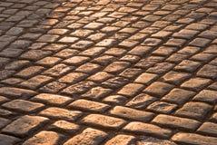 Pavement stones. Under warm sunset light Royalty Free Stock Photography