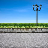 Pavement and street light. On blue sky Stock Images