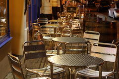 Pavement tables. Metal tables and chairs on the pavement outside trendy pubs and bars royalty free stock photo