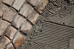 Pavement or terrace making, using recycling materials royalty free stock photo
