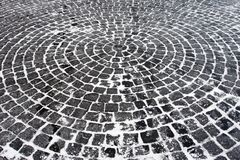 Pavement texture. Rings of cobble under snow Stock Photo