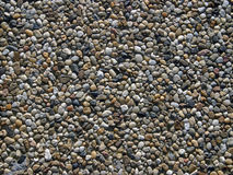 Pavement texture. Close-up on a sidewalk tile, showing arranged small stones Royalty Free Stock Image