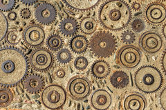 Pavement texture with gears and bricks in Montjuic, Barcelona, Spain. Stock Photos