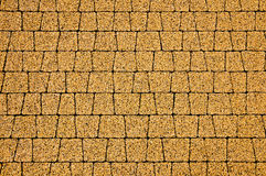 The pavement with yellow cobblestones Stock Image