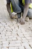 Paver Working with Hammer Stock Photo