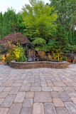 Paver Brick Patio with Waterfall Pond Royalty Free Stock Photos
