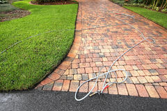 Paver driveway professionally cleaned royalty free stock photography