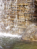 Paver Falls. Background of a small waterfall over a stone wall Royalty Free Stock Photos