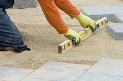 Paver leveling sand Royalty Free Stock Photo