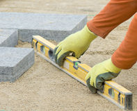 Paver leveling sand Royalty Free Stock Photo