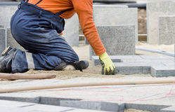 Paver working on knees Stock Photography