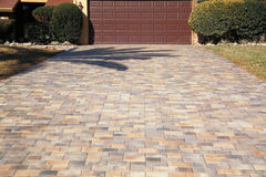 Pavers. Photo of pavers being applied to driveway Stock Photography