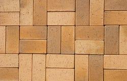 Pavers för Clinker för gul brunt för tappning keramiska för uteplats som en texturerad bakgrund för din text Arkivbild
