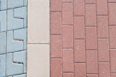 Pavers. Three different types of concrete pavers with each its own color : blue, grey and red Stock Photography