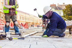 Pavers at work Royalty Free Stock Photography