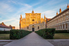 Pavia Carthusian monastery and gardens close up. View of the cathedral of Certosa di Pavia Carthusian monastery at sunset Royalty Free Stock Image