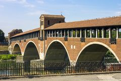 Pavia, Italy. The Ponte Coperto covered bridge, also known as the Ponte Vecchio old bridge, a brick and stone arch bridge over the Ticino River in Pavia, Italy Royalty Free Stock Photos