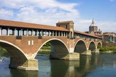 Pavia, Italy. The Ponte Coperto covered bridge, also known as the Ponte Vecchio old bridge, a brick and stone arch bridge over the Ticino River in Pavia, Italy stock photos