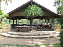 Pavilion. This Pavilion at Lake Seminole Park, Seminole Florida has a garden type picnic area at one end and overlooks a lake at the other end Stock Photo