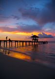 Pavilion on the beach with sunset Stock Photos