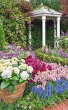 Flower garden. Pavilion in beautiful flower garden royalty free stock photos