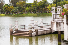Pavilion with bridge extend to lake in the park Stock Photography