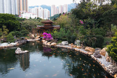 Pavilion Bridge stands on the end of Blue Pond. Blue Pond and Pavilion Bridge, Nan Lian Garden, Diamond Hill, Kowloon, Hong Kong royalty free stock photography