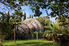 Pavilion of a bus stop in the shape of a shell, decorated with mosaics. New Athos, Georgia - 09/24/2018: Pavilion of a bus stop in the shape of a shell royalty free stock photos