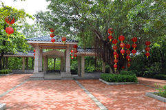 Pavilion. Chinese ancient architectural style pavilion covered with red lanterns in front of a tree class Royalty Free Stock Photos