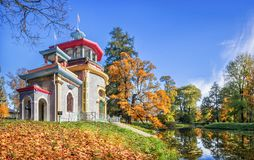 Pavilion Chinese arbor on a hillock and a pond. With autumn leaves in Tsarskoe Selo on an autumn sunny day royalty free stock photo